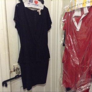 Short peplum dress with lace detail & low neckline